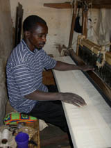Fabrics being weaved by a man